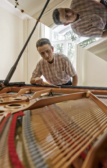 Andrey Ageenko restores and tunes musical instruments