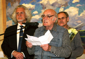 Artist Yevgeny Shibnev (centre) at the exhibition opening