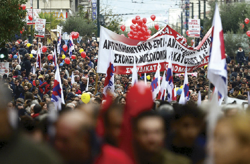 Unionists affiliated to the Communist Party march during a 24-hour nationwide general strike in Athens