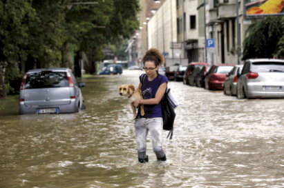 Floods and landslides have killed two people on the Swiss-Italian border